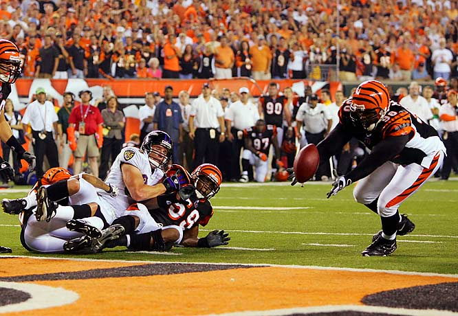 Ravens tight end Todd Heap watches Bengals lineman Michael Myers make a diving interception on a pass from Kyle Boller that had bounced off Heap's shoulder with 1:13 to go. Steve McNair, out with a strained groin late in the game, had a hand in four of the Ravens' six turnovers.