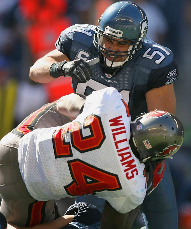 "Linebacker Lofa Tatupu led Seattle's hard-hitting defense with eight tackles, including a collision with Carnell ""Cadillac"" Williams that sent the Bucs running back to the locker room with a rib injury."