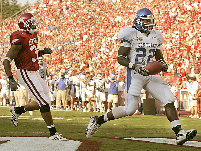 Rafael Little celebrates after scoring Kentucky's first touchdown on a 14-yard run.