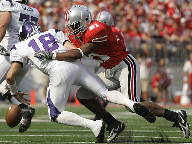 Ohio State's Anderson Russell forces a fumble on Northwestern quarterback C.J. Bacher. The ball was scooped up by Vernon Gholston, who rumbled in for a touchdown and a 28-0 lead.