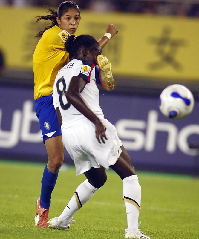 Tina Ellertson and Brazil's Cristiane battle for control.
