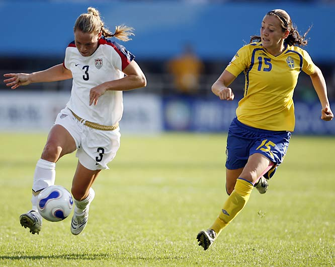 U.S. defender Christie Rampone's holds off Therese Sjogran.