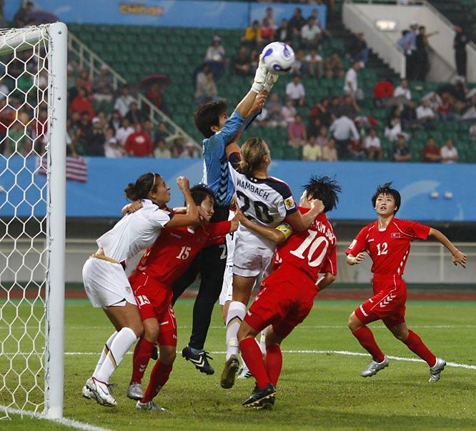 North Korean goalie Jon Myong Hui makes a save in front of Abby Wambach.