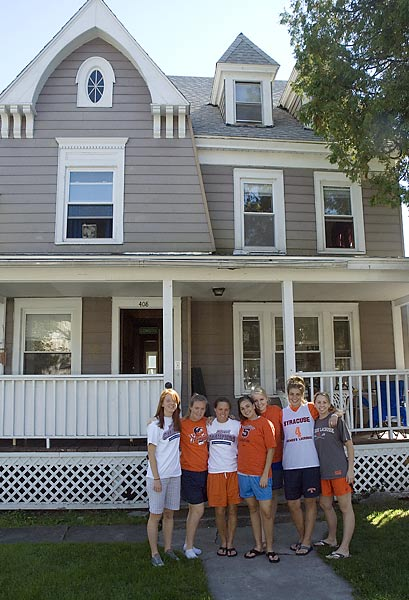Welcome to the home of Syracuse seniors Shannon Brushe, Bridget Looney, Kristin Brady, Christina Gibson and Stephanie Bissett, all members of the Orange lacrosse team, and their two friends Jillian Malm (third from right) and Darcy Benedict (far right). The seven-bedroom house on Euclid Avenue is in the heart of the University neighborhood, just adjacent to campus.