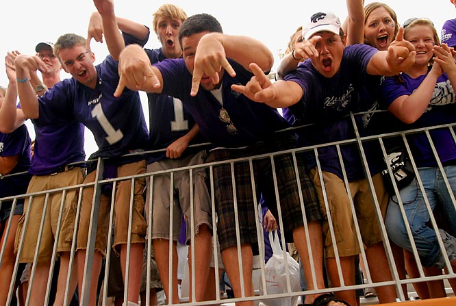 Kansas State fans hang over the rails during the Wildcats' 41-21 upset over Texas.
