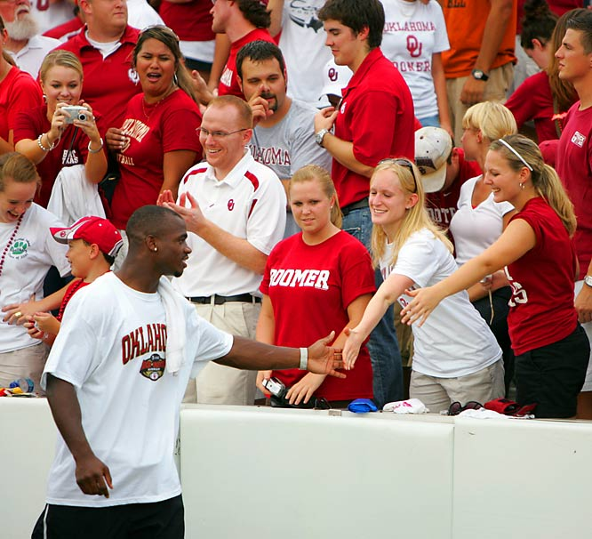 Former Sooner Adrian Peterson is welcomed by fans upon his return to Norman.