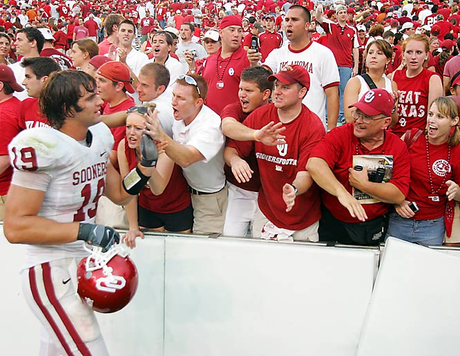 Oklahoma TE Joe Jon Finley slaps hands with Sooner fans after OU's 28-21 victory over Texas.