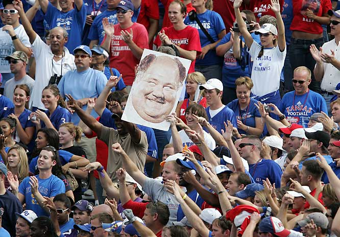Kansas  fans hold up a sign of head coach Mark Mangino following the Jayhawks 30-24 win over Kansas State.