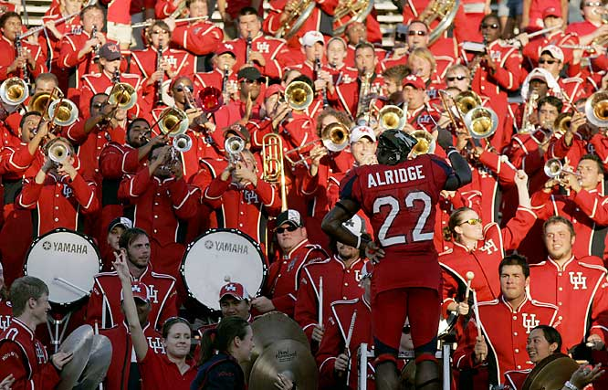 Houston RB Anthony Aldridge conducts the marching band after the Cougars retained the Bayou Bucket by defeating Rice.