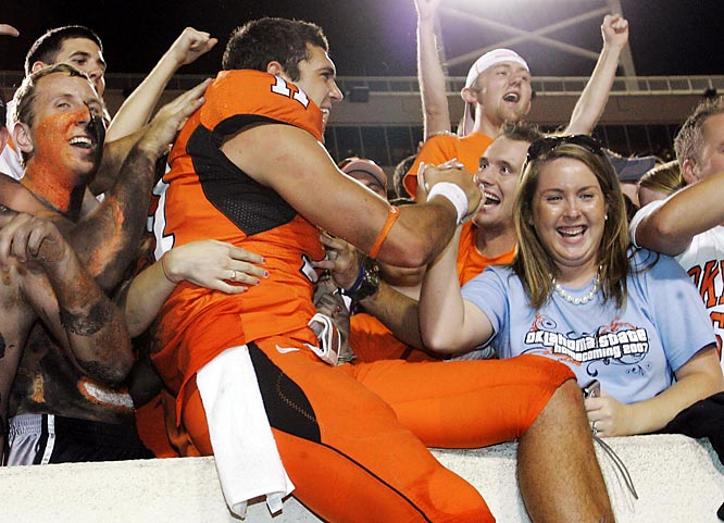 Oklahoma State QB Zac Robinson celebrates with fans after the Cowboys defeated Kansas State, 41-39.