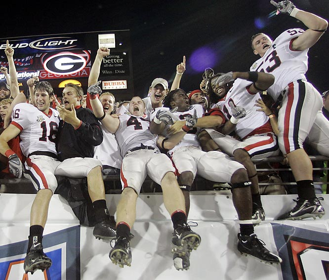 Georgia players celebrate with the fans following their victory over UF.