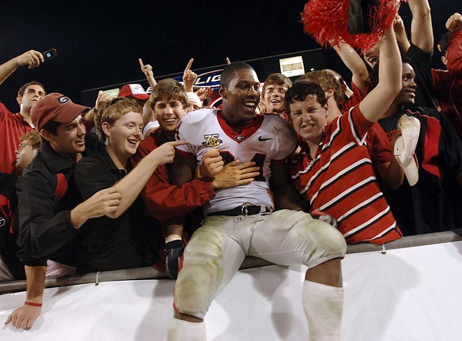 Georgia tailback Knowshon Moreno (24) celebrates with fans in the end zone after UGA defeated Florida, 42-30.