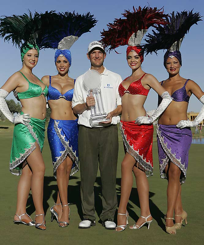 George McNeill not only got a trophy for winning the Frys.com Open, but also got to pose with showgirls.