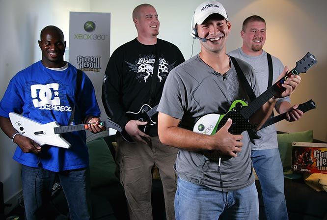 Terrance Newman (from left to right), Marc Colombo, Tony Romo and Cory Procter took part in a little Guitar Hero III at Newman's last Tuesday.