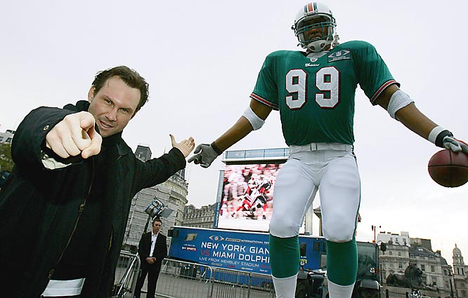 """Actor Christian Slater helped unveil """"Big JT"""" -- a 26-foot animatronic version of Miami Dolphins defensive end Jason Taylor."""