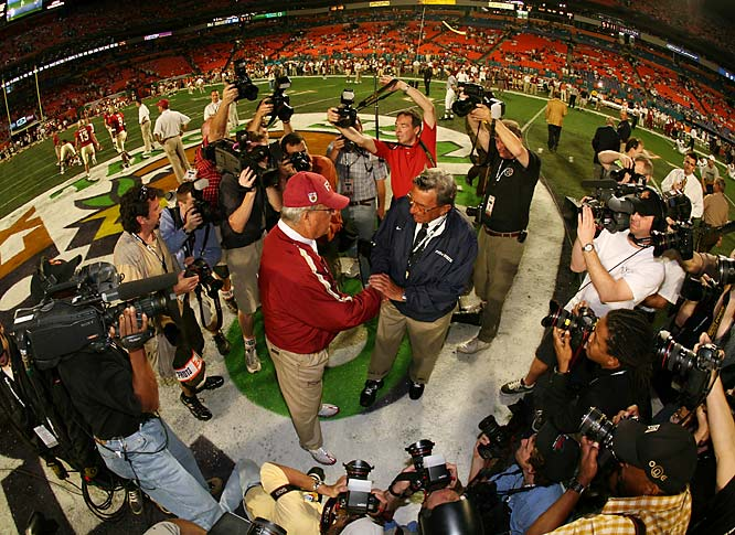 Coaching legends Bobby Bowden and Joe Paterno are strangers to no one, and the media attention was huge for their Orange Bowl matchup. I wanted to illustrate this as the coaches met on the field for the first time, so I mounted a camera on a pole with a fisheye lens and triggered it remotely so I could show the media frenzy and the environment.<br><br>Shot with: Canon EOS-5D, EF 15mm f/2.8 shot at 1/500 F/4