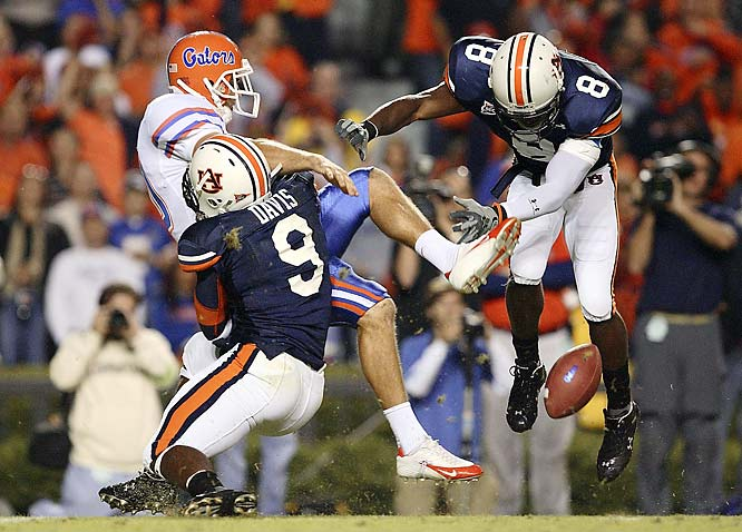 Being in position to make a picture of a game-changing moment is critical in our business, and I was fortunate to make this one when Auburn blocked a punt against Florida last year. Auburn scored a touchdown on the play and went on to beat Florida, which ultimately was the only blemish on Florida's record as they won the 2006 National Championship. My position behind the line of scrimmage yielded this picture, once again illustrating the significance of being in the right place at the right time.<br><br>Shot with: Canon EOS-1D Mark II N, EF 300mm f/2.8L IS USM, shot at 1/800 f/2.8