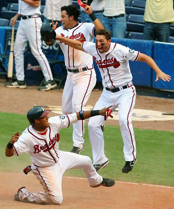 Anticipating a possible game-winning situation, I had a feeling that if the Braves came back from being down several runs, the reaction to winning in the bottom of the ninth would be dramatic. The hunch paid off as Yunel Escobar scored the winning run. <br><br>Shot with: Canon EOS-1D Mark III, EF 400mm f/2.8L IS USM, shot at 1/1000 f/4.0