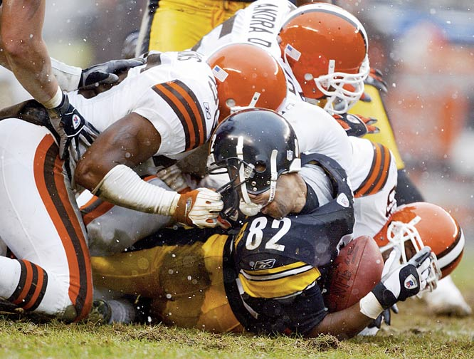 Antwaan Randle El was returning a kickoff in a cold, wintery playoff game when  he was tackled by a Cleveland player who grabbed his facemask and violently twisted his helmet. I remember shooting through the play as the tackle occurred, but had no idea how dramatic the image was until much later. Thankfully, Randle El was not seriously injured. <br><br>Shot with: Canon EOS-1D, EF 600mm f/4.0L USM, shot at 1/640 f/4.0