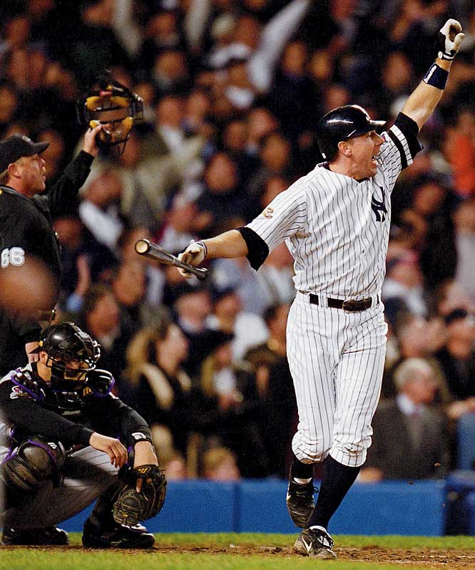 For the second time in less than 24 hours, the Yankees got a game-tying two run homer with two outs in the ninth inning against Arizona's Byung-Hyun Kim. In Game 4 it was Tino Martinez and in Game 5 it was Scott Brosius (pictured) who rescued New York. The Yankees went on to win Game 5 in extra innings.