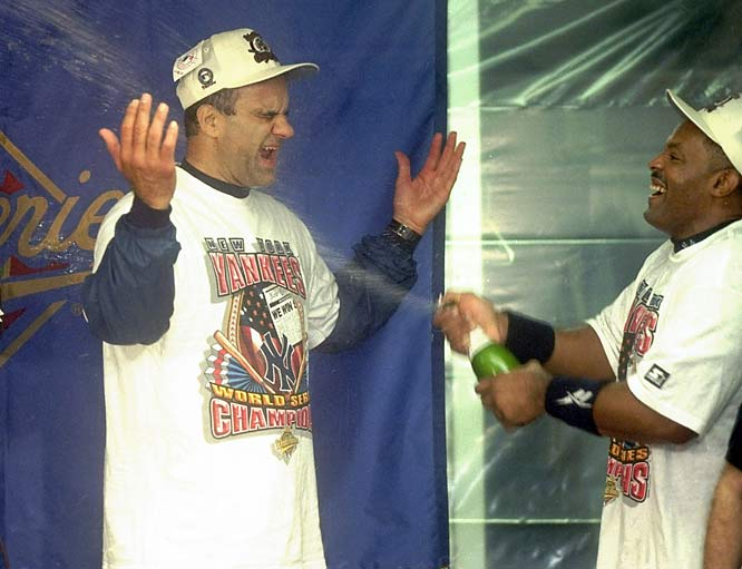 Cecil Fielder sprays Torre with champagne in the winning locker room after Game 6 of the 1996 World Series.