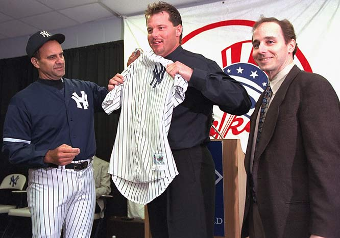 Torre and GM Brian Cashman welcome Roger Clemens to the Yankees after an offseason trade in February 1999.