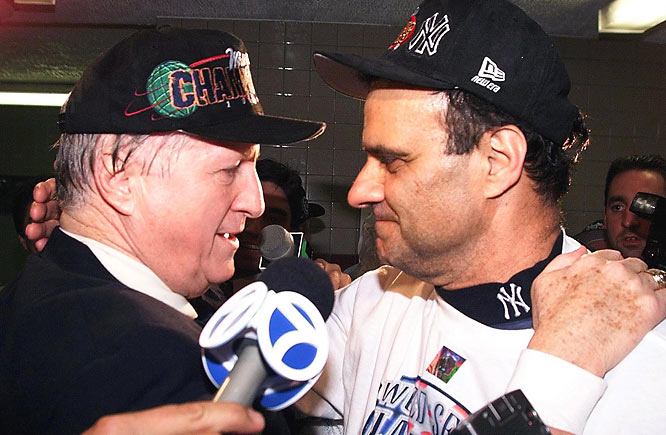 George Steinbrenner and Torre share an embrace after the Yankees' sweep of the Padres in the 1998 World Series.