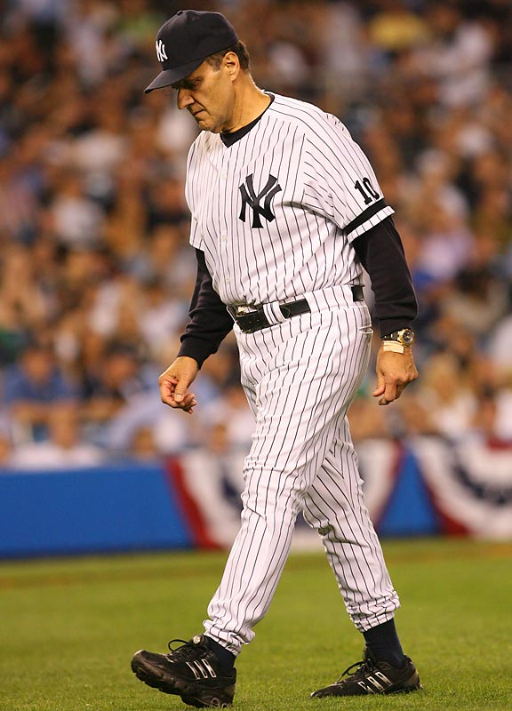 Torre leaves the field during the Yankees' season-ending loss to the Indians in Game 4 of the 2007 Division Series.