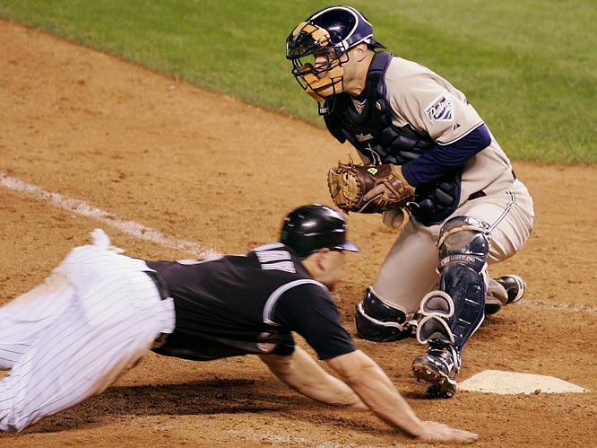 Colorado's Matt Holliday scored the winning run when Padres catcher Michael Barrett bobbled the ball in the bottom of the 13th inning of the NL wild card tiebreaker. Umpire Tim McClelland made a delayed safe call but replays suggested Holliday may have missed the plate, which was blocked by Barrett's left foot.
