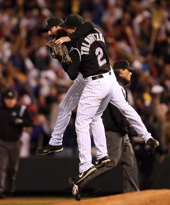 After he caught the final out, Todd Helton got a bear hug from Troy Tulowitzki.