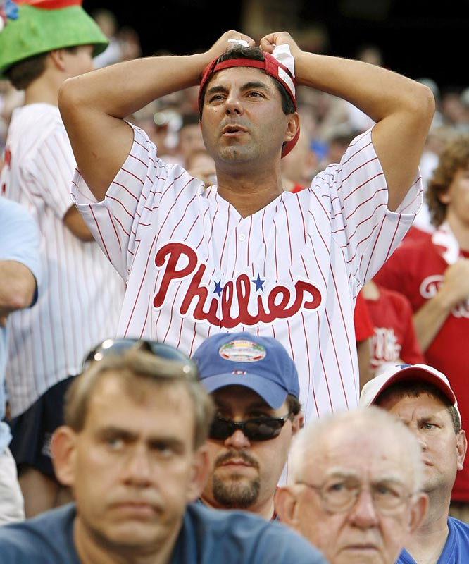 A Phillies fan is left with a sour feeling after the Rockies continued their hot streak into the postseason and stunned the Philadelphia faithful with a 4-2 victory in Game 1.