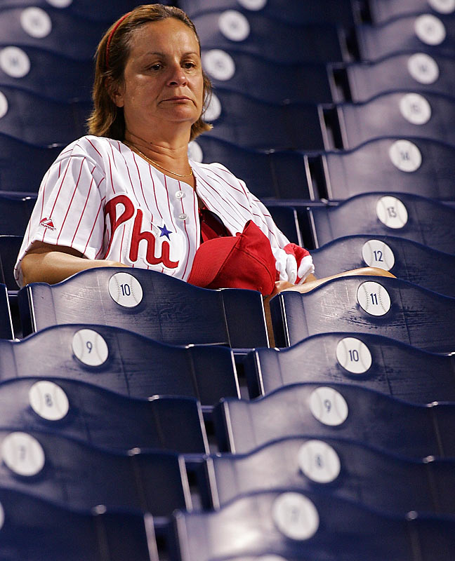 A dejected Philly fan sulks in her seat as the stadium empties after the Phillies dropped Game 2 to the Colorado Rockies.