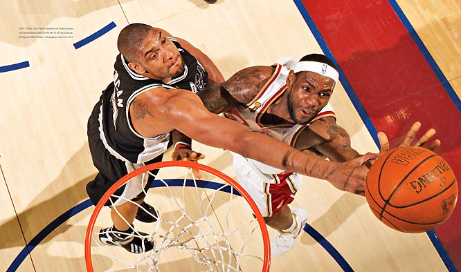 LeBron James' driving ambition was momentarily diverted by Tim Duncan's defense during the 2007 NBA Finals.