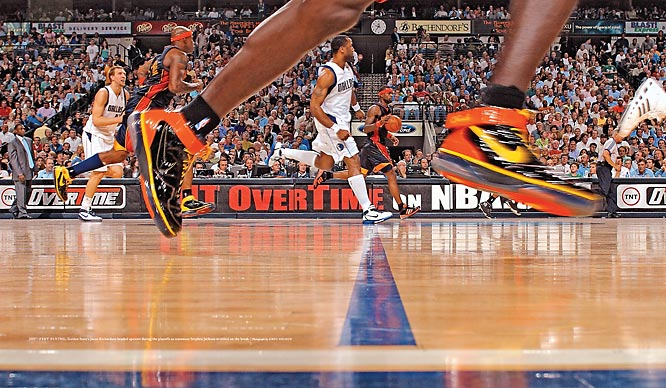 Feet flying, the Warriors' Jason Richardson headed upcourt during the 2007 playoffs as teammate Stephen Jackson dribbled on the break.