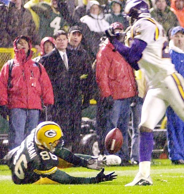 Gary Anderson's botched 33-yard field goal attempt in the driving rain on the final play of regulation gave the Packers a glimmer of hope. Brett Favre launched a third-down bomb to Antonio Freeman, who slipped on the turf as cornerback Chris Dishman deflected the pass. The ball bounced off Freeman's left shoulder as he rolled over, but the receiver corralled the ball into his chest and jumped up before getting touched. Freeman sprinted 20 yards for the incredibly unlikely but perfectly legal game-winning score.