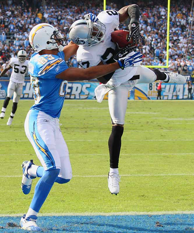 Raiders' cornerback Fabian Washington nearly intercepts a pass intended for Vincent Jackson in the end zone during the third quarter.