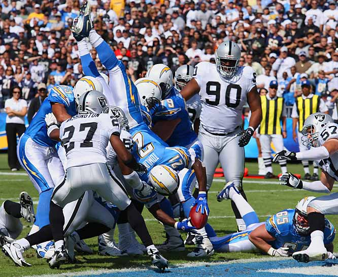 LaDainian Tomlinson dives into the end zone for a 3-yard touchdown run in the first quarter.