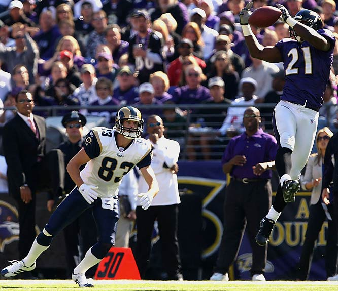 Intended receiver Drew Bennett watches Ravens cornerback Chris McAlister intercept a pass by Gus Frerotte in the second quarter. Frerotte threw five interceptions in the game.