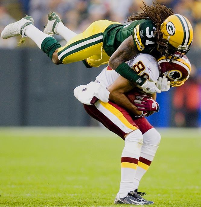 Packers' cornerback Al Harris tackles Keenan McCardell in the second half.