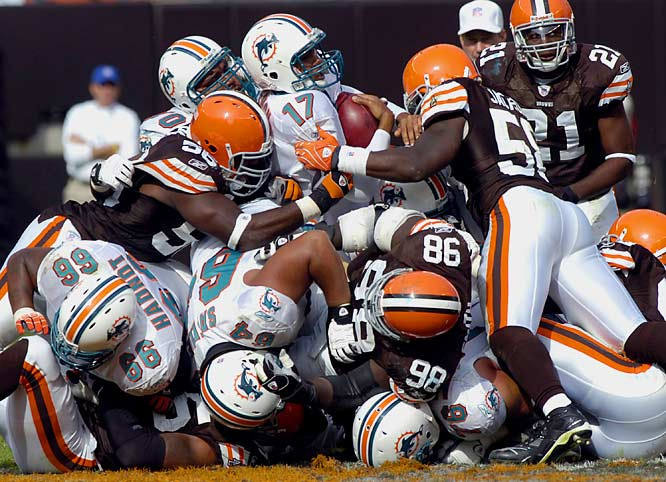 Dolphins quarterback Cleo Lemon jumps over the pile for a first down in the third quarter.
