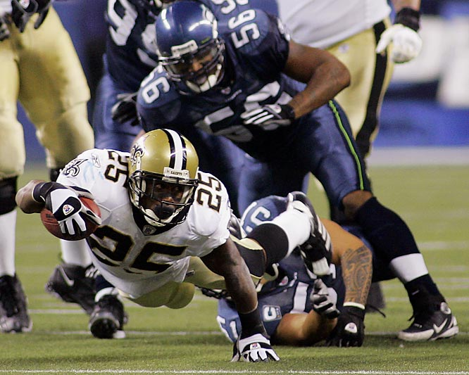Reggie Bush dives for extra yardage against the Seahawks in the third quarter.