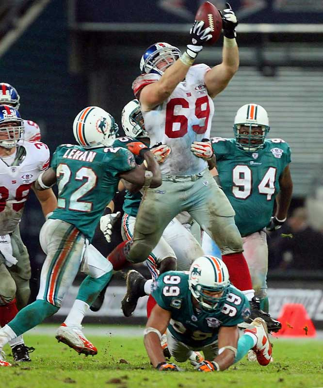 Guard Rich Seubert saves the Giants possession by snatching a fumble after Dolphins safety Jason Allen jarred the ball loose from running back Brandon Jacobs in Wembley, England.
