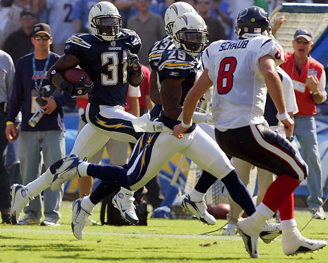 Antonio Cromartie returns his second interception 70 yards for a touchdown while teammates Drayton Florence (29) and Quentin Jammer (23) look to block Texans quarterback Matt Schaub during the second quarter.  Cromartie also recovered a fumble for a touchdown late in the first quarter.