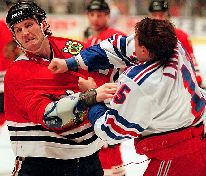 He who lives by the fist, looks like it. Probert, a pugnacious presence from 1985 to 2002, had a little cosmetic surgery performed on his puss by Darren Langdon of the Rangers in 1997.