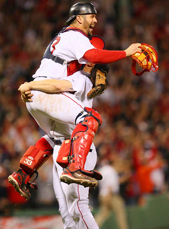 Mobbed by Johnathan Papelbon, Jason Varitek cannot believe that the Red Sox made a comeback from a 3-1 series deficit.