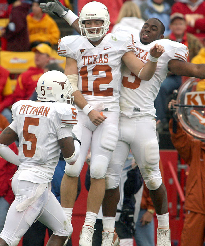 Colt McCoy (12) threw four touchdown passes and ran for another as the Longhorns ripped the Cyclones to pick up their first Big 12 victory of the season.