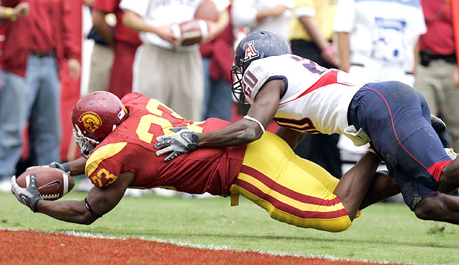 Chauncey Washington ran for 54 yards, including an 18-yard touchdown, for the Trojans, who had to rally to beat the Wildcats.