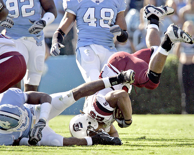 Mike Davis and the Gamecocks defended their first top 10 ranking since 2001 and gave coach Steve Spurrier his fourth straight win over the Tar Heels.