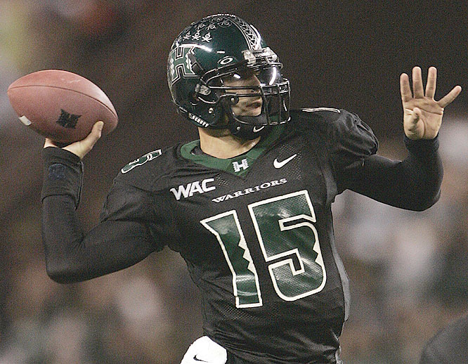 Colt Brennan threw for 425 yards and six touchdowns, breaking Timmy Chang's team record for TD passes, as the Warriors improved to 8-0 for the first time since 1973.