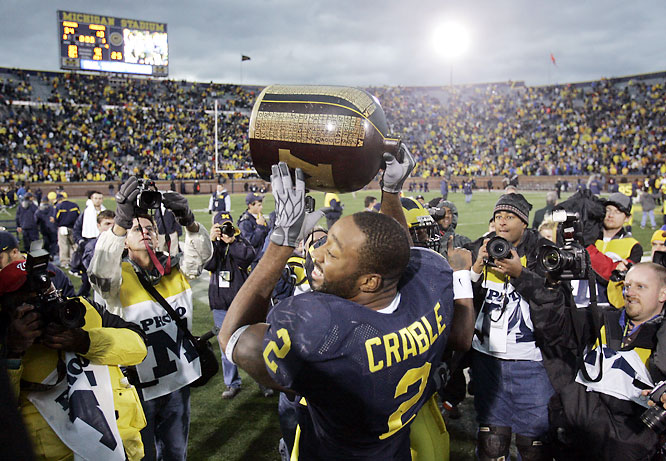 Playing without star RB Mike Hart and QB Chad Henne, the Wolverines struggled during the first half. But Michigan scored 21 unanswered points in the second half and retained the Little Brown Jug trophy.